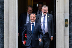 © Licensed to London News Pictures. 10/07/2018. London, UK. Secretary of State for Wales Alun Cairns (2-L) and Scotland Secretary David Mundell (4-L) leave 10 Downing Street after the Cabinet meeting, followed by Education Secretary Damian Hinds (L) and Secretary of State for Culture, Media and Sport Jeremy Wright QC (3-L). Photo credit: Rob Pinney/LNP