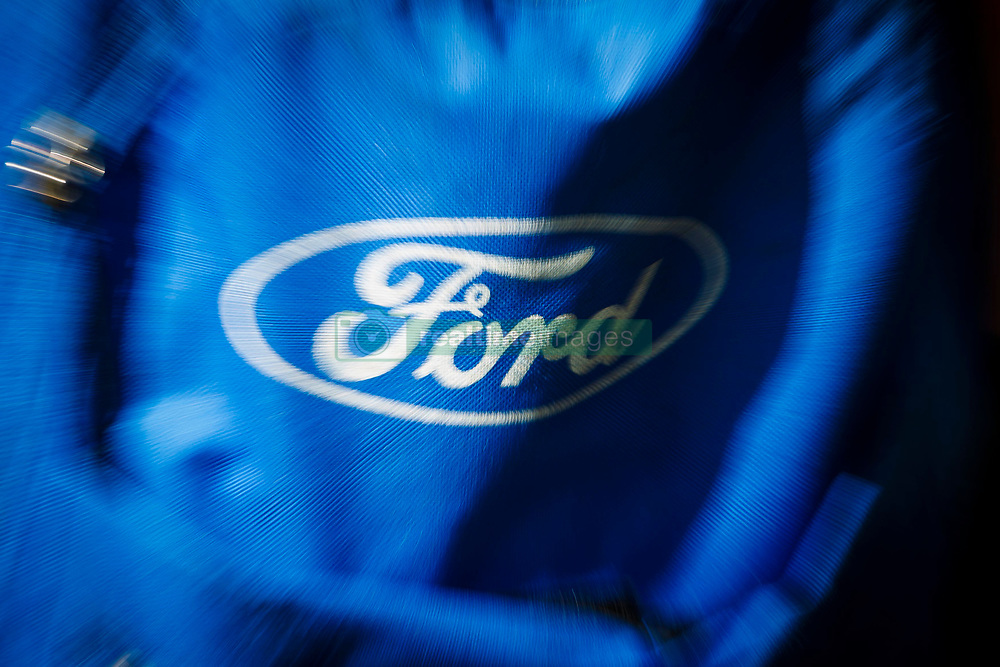 File photo dated 24/07/13 of a Ford logo on a rucksack. Leading trade union, Unite, has warned it will not accept compulsory redundancies if jobs are lost at a Ford engine plant under cuts by the car giant.