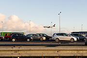 File on the highway, plane is landing on Schiphol, Netherlands