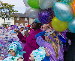 © Licensed to London News Pictures. 04/05/2012..Dormanstown, Middlesbrough, England..The Archbishop of York, the most Revd and Rt Hon Dr John Sentamu visited schools and charities in Cleveland today..He officially opened the new look Dormanstown Primary School, which opened to pupils in September last year at a cost of £4.75 million..The Archbishop led a procession to the school along the South Avenue area of Dormanstown accompanied by pupils from the school wearing different costumes. As the procession made its way along the Avenue pupils from Redcar Community College played drums..After arriving at the school plaza the formal opening ceremony took place which included the release of 400 balloons...Photo credit : Ian Forsyth/LNP