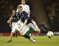 Fotball<br /> 08.09.2004<br /> Skottland v Slovenia<br /> Foto: SBI/Digitalsport<br /> NORWAY ONLY<br /> <br /> Scotland's Darren fletcher tumbles with Slovenia's Amir Karic