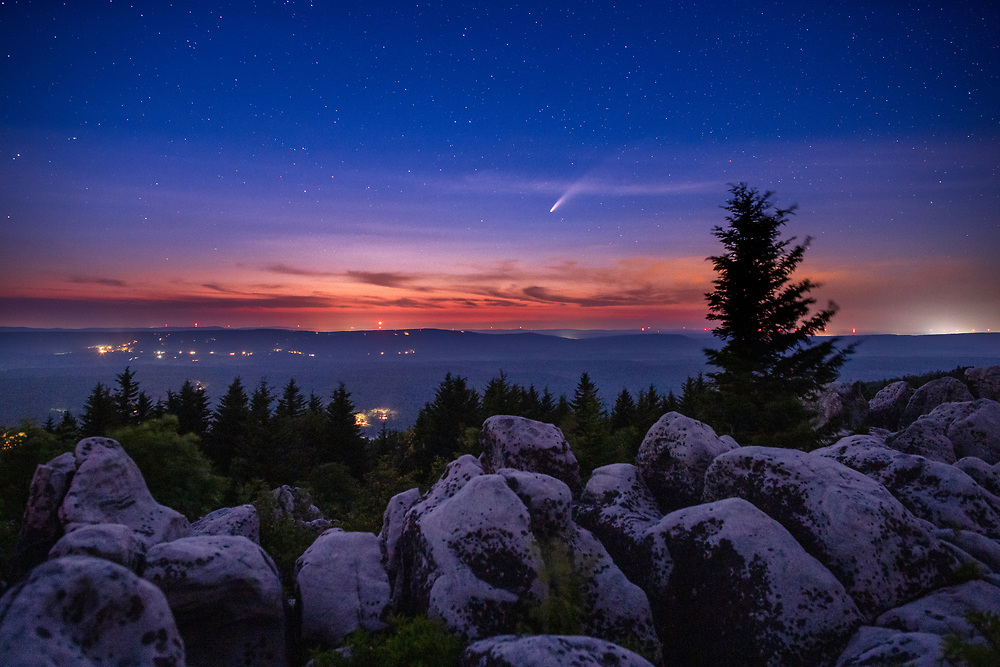 The comet NEOWISE can be seen in the darkening summer twilight above Canaan Valley, West Virginia from a high vista on the western edge of the Dolly Sods Wilderness Area.