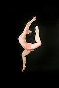 Young female modern dancer On black Background