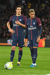 Edinson Cavani and Neymar Jr of PSG during the Ligue 1 match between Paris Saint Germain and Olympique Lyonnais at Parc des Princes on September 17, 2017 in Paris, France. one of the big talking points from the match was the apparent tension between Cavani and the world's most expensive player, Neymar. Cavani won an argument to take a penalty, only to then miss it, while Dani Alves got involved in a disagreement over a free-kick and gave the ball to his fellow Brazilian Neymar. Photo by Laurent Zabulon/ABACAPRESS.COM