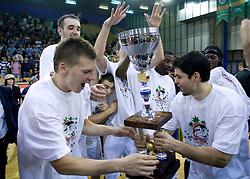 Jaka Klobucar and Saso Ozbolt celebrate at third finals basketball match of Slovenian Men UPC League between KK Union Olimpija and KK Helios Domzale, on June 2, 2009, in Arena Tivoli, Ljubljana, Slovenia. Union Olimpija won 69:58 and became Slovenian National Champion for the season 2008/2009. (Photo by Vid Ponikvar / Sportida)