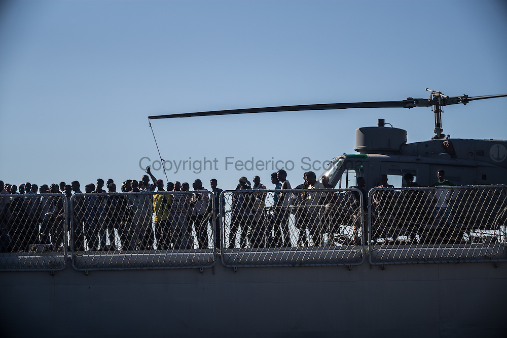 Landing in Augusta from the Italian Navy ship Espero, one of the many vessels used for the operation Mare Nostrum