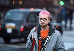© Licensed to London News Pictures. 29/03/2018. London, UK. Cambridge Analytica whittleblower CHRISTOPHER WYLIE arrives to speak at a demonstration held by Fair Vote, outside the Houses of Parliament in London, calling for a fair vote on the EU referendum. Whistleblowers Shahmir Sanni and Christopher Wylie both spoke at the event attended by a small number of people.. Photo credit: Ben Cawthra/LNP