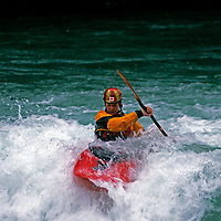 KAYAKING. Andrew Jobe (MR) paddles on the Kananaskis River, near Calgary, Alberta, Canada.