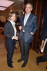 JAMES GILBEY and his wife LAVINIA at a party to celebrate the publication of Interiors For Living by Joanna Wood held at Christie's. 8 King Street, St.James's, London on 2nd March 2015.