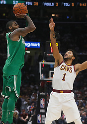 October 17, 2017 - Cleveland, OH, USA - The Boston Celtics' Kyrie Irving, left, puts up a shot over the Cleveland Cavaliers' Derrick Rose in the third quarter on Tuesday, Oct. 17, 2017, at Quicken Loans Arena in Cleveland. (Credit Image: © Leah Klafczynski/TNS via ZUMA Wire)
