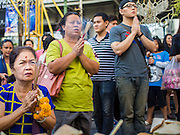 31 DECEMBER 2014 - BANGKOK, THAILAND: People pray on New Year's Eve at Erawan Shrine in Bangkok. Hundreds of thousands of people pack into the Ratchaprasong Intersection in Bangkok for the city's annual New Year's Eve countdown. Many Thais go the Erawan Shrine and Wat Pathum Wanaram near the intersection to pray and make merit before going to their New Year's parties.    PHOTO BY JACK KURTZ