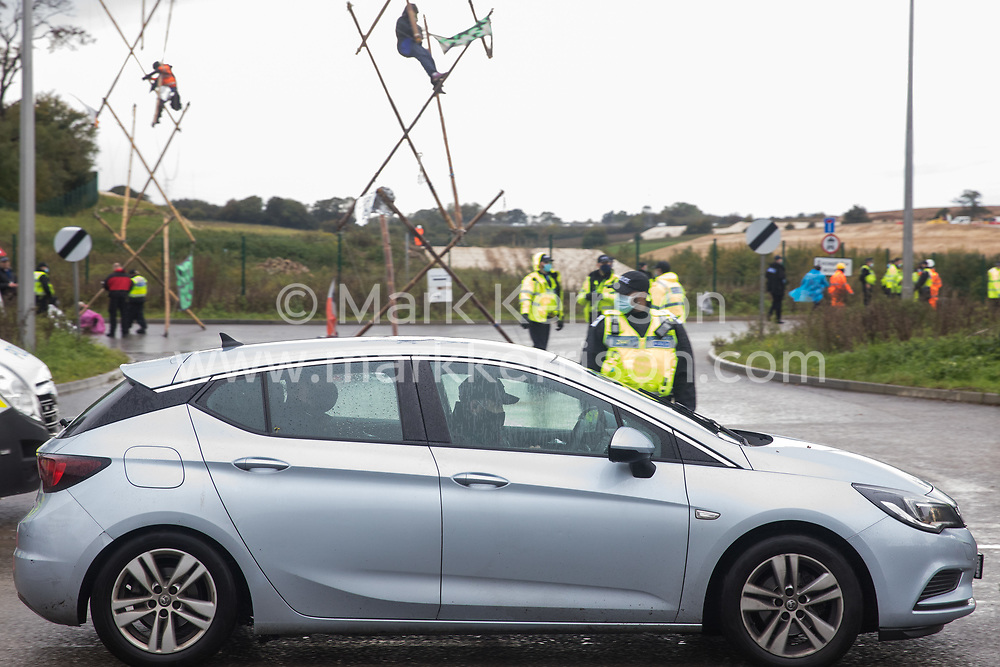 West Hyde, UK. 9th September, 2020. A Hertfordshire Police officer drives away an anti-HS2 activist arrested after Section 14 of the Public Order Act 1986 was invoked to clear an area outside an entrance to the Chiltern Tunnel South Portal site for the HS2 high-speed rail link. A protest action by anti-HS2 activists, at the site from which HS2 Ltd intends to drill a 10-mile tunnel through the Chilterns, was intended to remind Prime Minister Boris Johnson that he committed to remove deforestation from supply chains and to provide legal protection for 30% of UK land for biodiversity by 2030 at the first UN Summit on Biodiversity on 30th September.