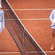 PARIS, FRANCE October 10.  Iga Swiatek of Poland and Sofia Kenin of the United States pose for a social distancing picture at the net before the Singles Final on Court Philippe-Chatrier during the French Open Tennis Tournament at Roland Garros on October 10th 2020 in Paris, France. (Photo by Tim Clayton/Corbis via Getty Images))