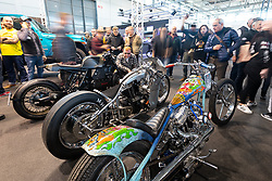 Bagger Nation's Paul Yaffe checking out Hazard Motorcycles' Matteo Fustinoni's Ghisarama 1984 Harley-Davidson Ironhead Sportster racer at the MBE award finals at Motor Bike Expo (MBE) bike show. Verona, Italy. Friday, January 17, 2020. Photography ©2020 Michael Lichter.