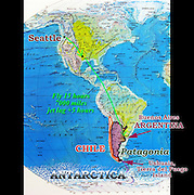 """A map of North and South America shows our flight from Seattle 7000 miles (through Dallas/Fort Worth, Texas) to Buenos Aires, taking 15 hours in the air. Argentina is plus 5 hours jet lag from Pacific Standard Time (West Coast, USA). Our adventure travel in Argentina and Chile lasted from February 3 to March 11, 2005. We flew 1500 miles from Buenos Aires to Ushuaia, on the Argentina side of the island archipelago of Tierra del Fuego. We cruised 12 days round trip through the Beagle Channel and across the rough 400-mile Drake Passage to explore the frozen Antarctic Peninsula. A short airplane flight took us from Ushuaia to working-class Punta Arenas in Chile, where a hired van drove us to the tourist town of Puerto Natales. We hiked the W Route to admire striking mountain scenery in Torres del Paine National Park, Chile. We bused into Argentina to the bustling tourist town of El Calafate, where day rental of a car let us visit the spectacular Moreno Glacier on our own schedule. A bus took us to the fun frontier village of El Chalten where several day hikes explored the awesome Mount Fitz Roy area. A flight from El Calafate returned to Buenos Aires. In Chile, Patagonia includes the territory of Valdivia through Tierra del Fuego archipelago. Spanning both Argentina and Chile, the foot of South America is known as Patagonia, a name derived from coastal giants (""""Patagão"""" or """"Patagoni"""" who were actually Tehuelche native people who averaged 25 cm taller than the Spaniards) who were reported by Magellan's 1520s voyage circumnavigating the world."""