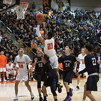 Gallup Bengal Jeffrey Yazzie (21) drives to the basket for a layup during their 1-4A semi-final tournament game against the Miyamura Patriots Wednesday night at Gallup High School. Gallup took the win 72-39.