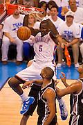 June 2, 2012; Oklahoma City, OK, USA; Oklahoma City Thunder center Kendrick Perkins (5) dunks over San Antonio Spurs forward Tim Duncan (21) during the first half of a playoff game at Chesapeake Energy Arena.  Mandatory Credit: Beth Hall-US PRESSWIRE