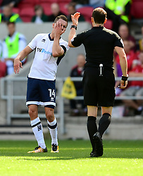 Jed Wallace of Millwall holds his face as he looks to referee, Darren England  - Mandatory by-line: Joe Meredith/JMP - 19/08/2017 - FOOTBALL - Ashton Gate Stadium - Bristol, England - Bristol City v Millwall - Sky Bet Championship