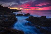 Stunning sunrise along the rocky coast of Acadia National Park, Maine, USA