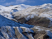 Snow-dusted peaks rising above the Salmon River north of Colston, Idaho.