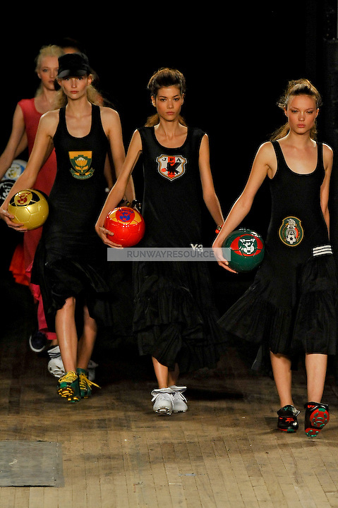 Katrin Thormann, Sheila Marquez and Naty Chabanenko walks the runway wearing Y-3 Spring 2010 collection during New York Mercedes-Benz fashion week on September 13, 2009.
