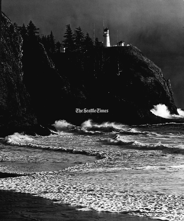 Winter surf crashed against the rocks below the Cape Disappointment Lighthouse. (Josef Scaylea / The Seattle Times, 1972)