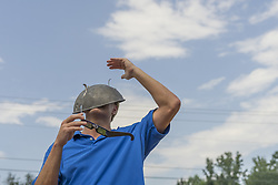 August 21, 2017 - Vernon, Alabama, U.S. - JOSEPH BURNETT gave the colander a try, but went back to the glasses while viewing the solar eclipse on Monday. The eclipse is the first coast-to-coast solar eclipse in almost 100 years and will pass across the U.S. at 2,000 mph. (Credit Image: © Tim Thompson via ZUMA Wire)