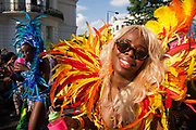 The 49th Notting Hill Carnival in West London. A celebration of West Indian / Caribbean culture and Europe's largest street party, festival and parade. Revellers come in their hundreds of thousands to have fun, dance, drink and let go in the brilliant atmosphere. Brightly coloured and feather costumes that symbolise the carnival parade.
