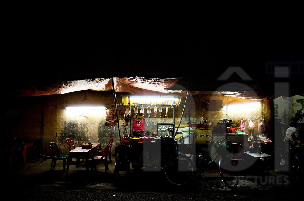 Street restaurant at night in Ho Chi Minh city, Vietnam, Southeast Asia