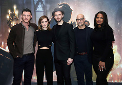 (left to right) Luke Evans, Emma Watson, Dan Stevens, Stanley Tucci and Audra Mcdonald during a photo call with the cast of Beauty and the Beast, at The Corinthia Hotel, London.