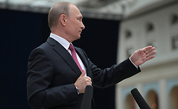 June 15, 2017 - Moscow, Russia - June 15, 2017. - Russia, Moscow. - Russian President Vladimir Putin answering journalists' questions on completion of the annual Q&A live nationwide broadcast from the Moscow Gostiny Dvor studio. (Credit Image: © Russian Look via ZUMA Wire)