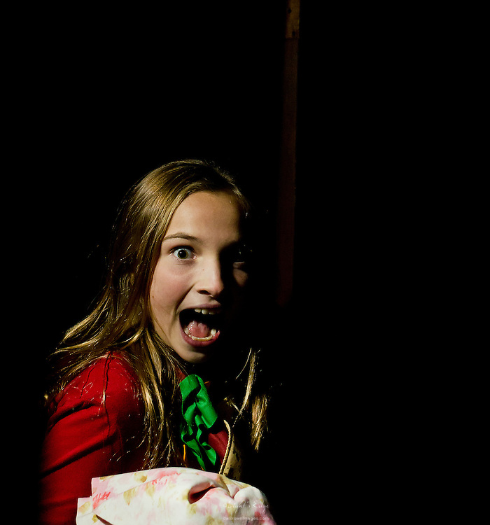 A startled look from a girl as she goes through Monster Martin's 2011 House of Horrors.