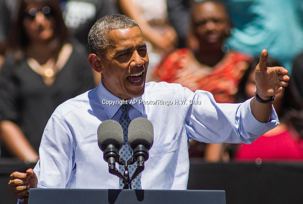 President Barack Obama speaks at Los Angeles Trade-Technical College in Los Angeles on Thursday, July 24, 2014.  (AP Photo/Ringo H.W. Chiu)
