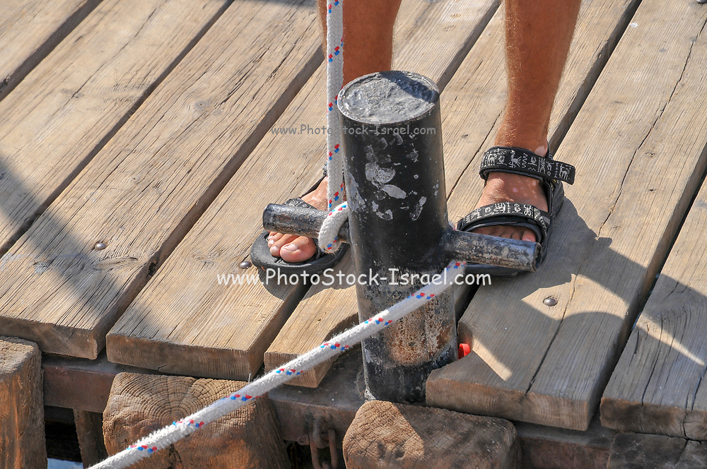 Securing a boat to the jetty with rope