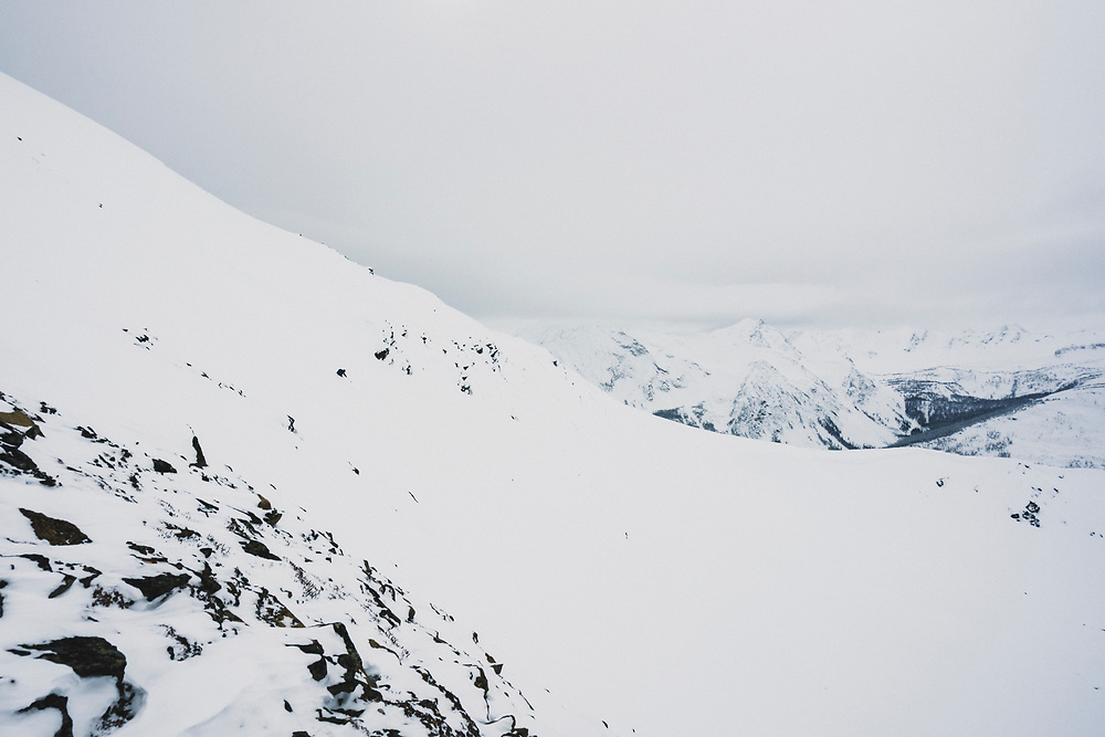 Chris Hassig skis northwest from the highest point in the Esplanade Range, Cupola Mountain (2632m), British Columbia