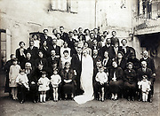 vintage 1930s group photo of groom and bride with families
