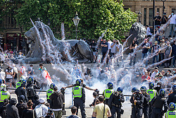 © Licensed to London News Pictures. 13/06/2020. London, UK. A firework explodes as Black Lives Matter and right-wing protesters clash in Trafalgar Square. Protests have taken place across the United States and in cities around the world in response to the killing of George Floyd by police officers in Minneapolis on 25 May. Photo credit: Rob Pinney/LNP