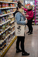 Elene, a volunteer member of the Donostia Helping Network, buys some food for Zuriñe who is on medical leave while she is in quarantine at her home. Donostia (Basque Country). April3, 2020. (Gari Garaialde / Bostok Photo)