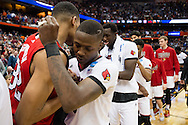 27 MAR 2015: Terry Rozier (0) of the University of Louisville embraces Kyle Washington (32) of North Carolina State University during the 2015 NCAA Men's Basketball Tournament held at the Carrier Dome in Syracuse, NY. Louisville defeated North Carolina State 75-65. Brett Wilhelm/NCAA Photos