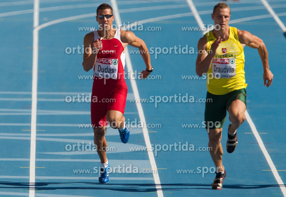 Mihail Dudas of Serbia and Darius Draudvila  of Lithuania compete in heat 1 during the men's decathlon 100m at the 2010 European Athletics Championships at the Olympic Stadium in Barcelona on July 28, 2010. (Photo by Vid Ponikvar / Sportida)