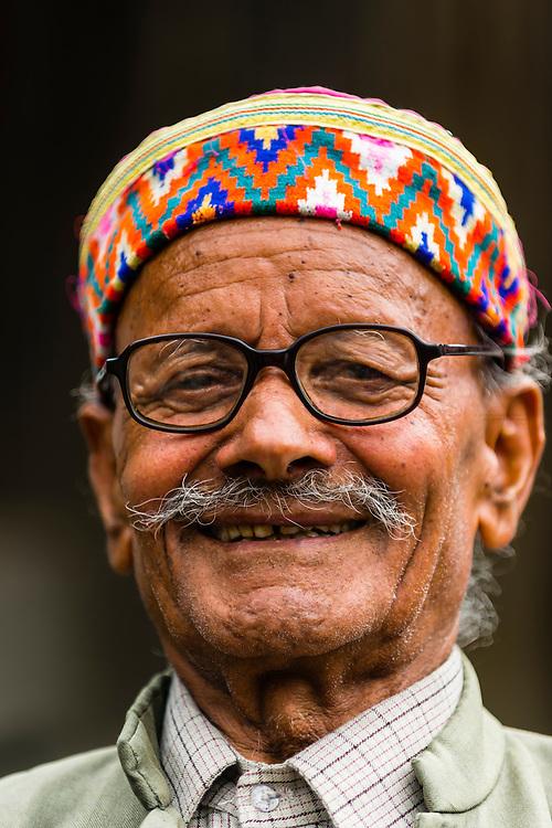A man wearing a Kullu cap, near Manali, Himachal Pradesh, India.