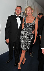 MATTHEW FREUD and ELISABETH MURDOCH at the GQ Men of The Year Awards 2012 held at The Royal Opera House, London on 4th September 2012.