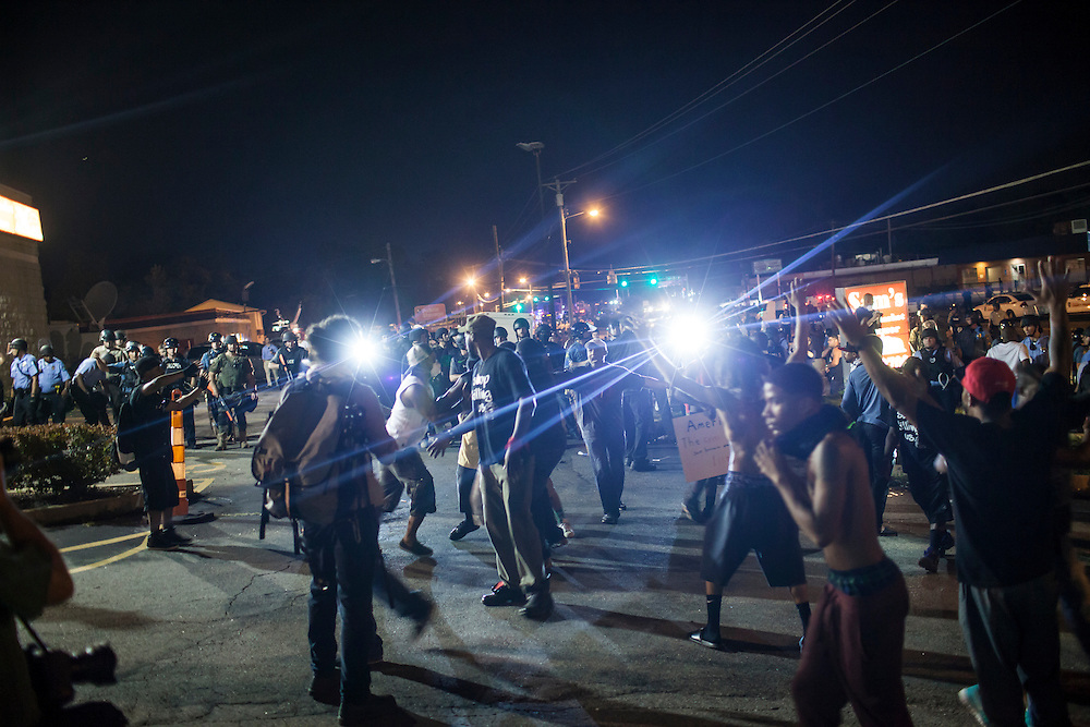 Media and protestors scramble as the Police Line gets smaller and smaller during continued protests in Ferguson, Mo. on August 19th, 2014. (Samuel Corum/Legion Photo)