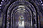 Conduit Court light installation infinity chamber of reflected lightbulbs on 25th February 2020 in London, United Kingdom. Here tourists and local people alink stop to take pictures and enjoy the optical illusion.