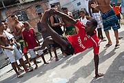 Serious dance moves. Young men guys on a rooftop dancing passinho to funk Carioca, Baile funk, Vila Valquiere, West Zone Zona Oueste, Rio de Janeiro