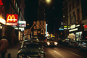 Neon lights at night city centre of Amsterdam, Netherlands 1970s - 1980s, Macdonalds fast food restaurant