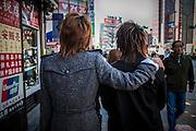 TOKYO, JAPAN - 25 FEBRUARY - Shinjuku - Two men walk in the street one have a hand on the shoulder of the other - February  2010 [FR] Deux hommes marchent dans les rues du Shinjuku. L'un mets sa main sur l'epaule de l'autre