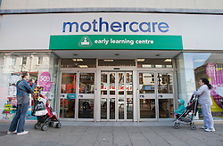 © licensed to London News Pictures. London, UK 12/04/2012. Two mothers with their children waiting outside Mothercare before the shop opens this morning in Wood Green (12/04/12). Mothercare expected to be shutting 111 stores with 700 job losses. Photo credit: Tolga Akmen/LNP