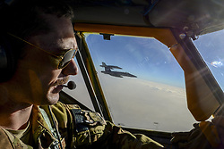 May 21, 2017 - Qatar - Air Force Capt. Timothy Black pilots a KC-135 Stratotanker on a combat refueling mission over Southwest Asia while two Navy F/A-18C Hornets fly alongside it, May 21, 2017. The Stratotanker is assigned to the 340th Expeditionary Air Refueling Squadron, which supports Operation Inherent Resolve. (Credit Image: ? A. Moseley/Air National Guard/DoD via ZUMA Wire/ZUMAPRESS.com)
