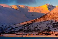 Winter landscape along the coastline near Tromso, Arctic, Northern Norway at sunrise.